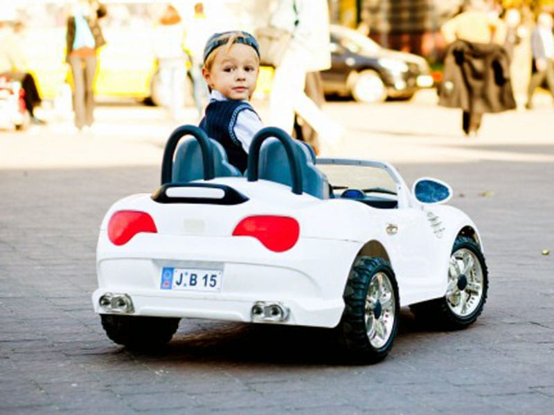 boy driving car