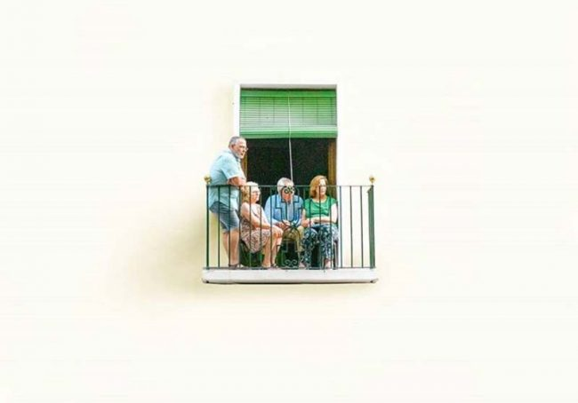 people sitting in a small balcony