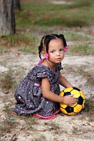 Girl in dress holding ball