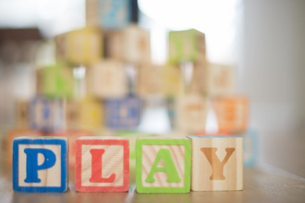Wooden blocks with letters spelling play
