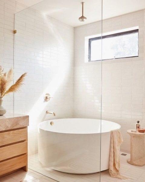 simple white bathroom small tiles window