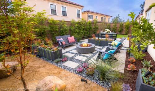 modern backyard with fireplace